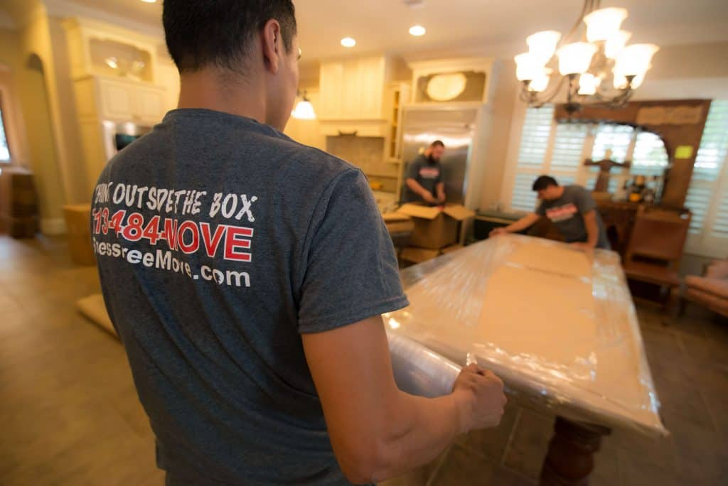 Ameritex furniture movers wrap, protect, and move large table